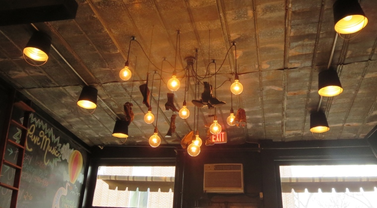 Quirky shoe chandelier at Shoe's Cup and Cork