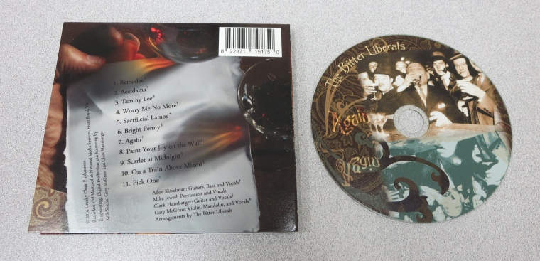 The CD art and the back cover of The Bitter Liberals new CD Again