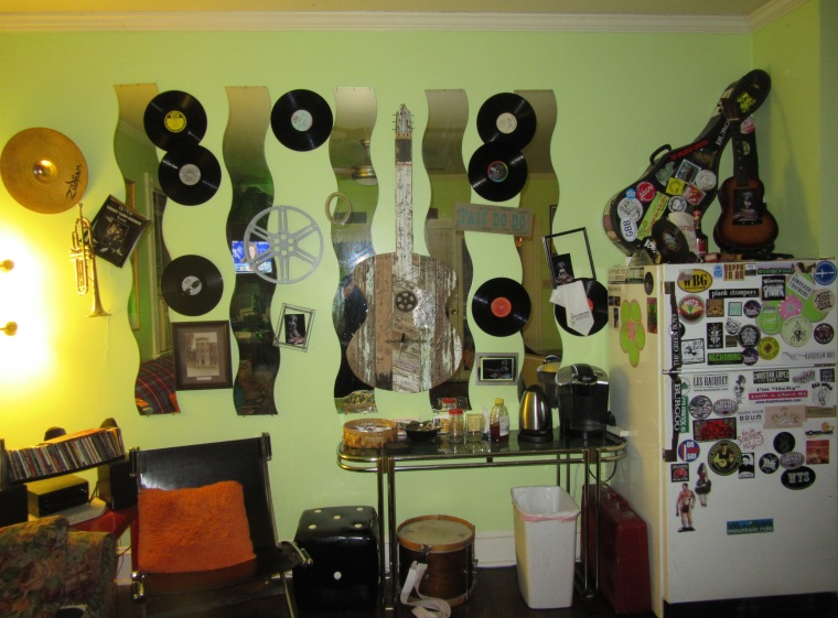 Wall o records with signed guitar art